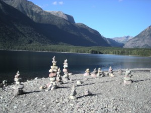 Rock balancing on the shore of a mountain lake in Glacier National Park in Montana.